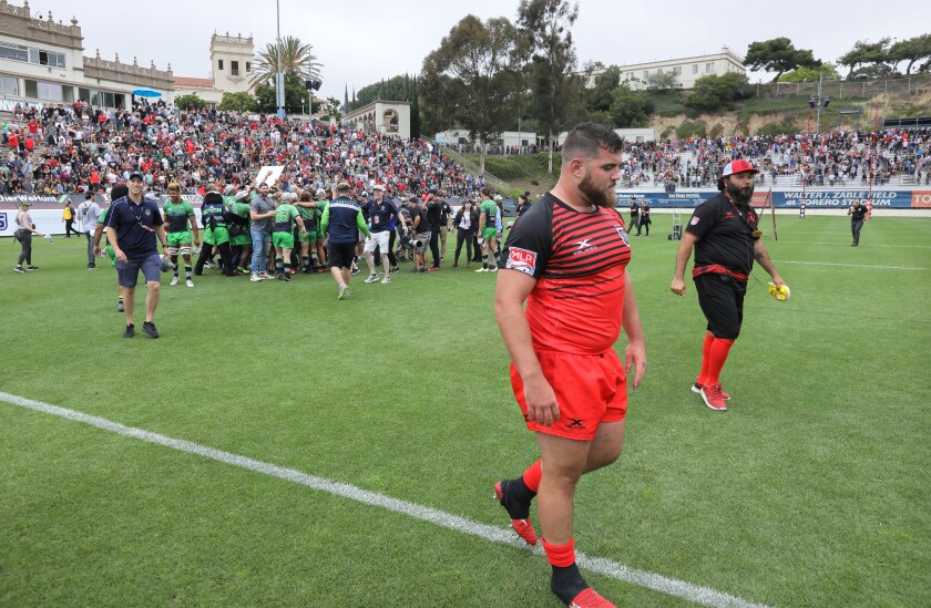 San Diego Legion's Dino Waldren walks away as the Seattle Seawolves celebrate their victory in the MLR championship game.