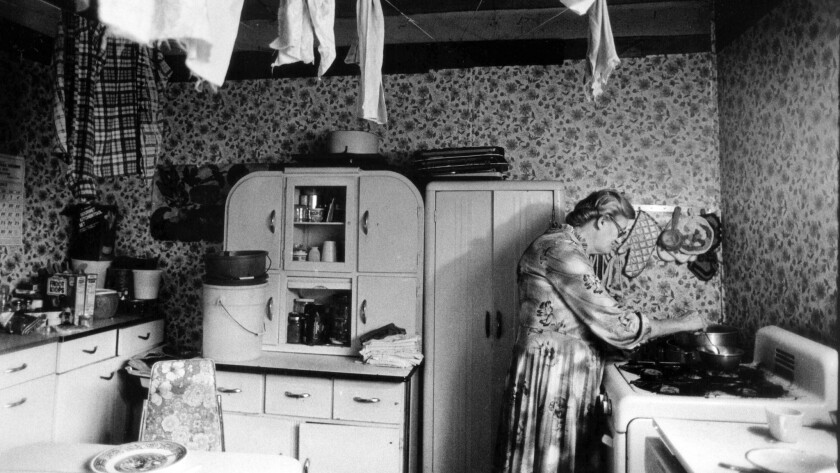 Ada Thompson cooks in her kitchen along Cabin Creek in West Virginia. She collects a total of $4,992 a year counting food stamps.