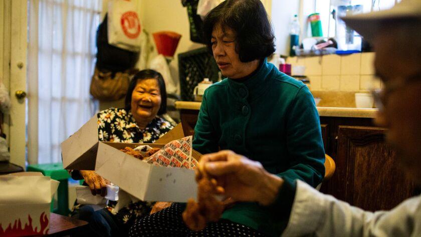 LOS ANGELES, CALIF. - MAY 23: for Pang Yun Fei, 77, Mei Wong, 67, and Lizong Huang, 75 try Nashville