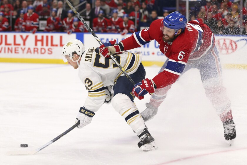 Buffalo Sabres forward Jeff Skinner (53) is checked by Montreal Canadiens defenseman Shea Weber (6) during the third period of an NHL hockey game Thursday, Jan. 30, 2020, in Buffalo, N.Y. (AP Photo/Jeffrey T. Barnes)