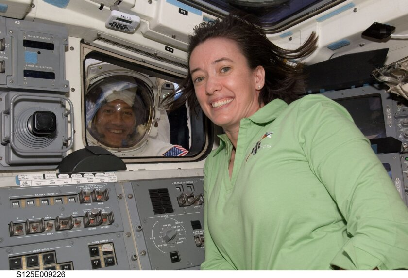 Megan McArthur, a UCSD graduate, helped repair the Hubble Space Telescope aboard the space shuttle Atlantis in 2009. NASA
