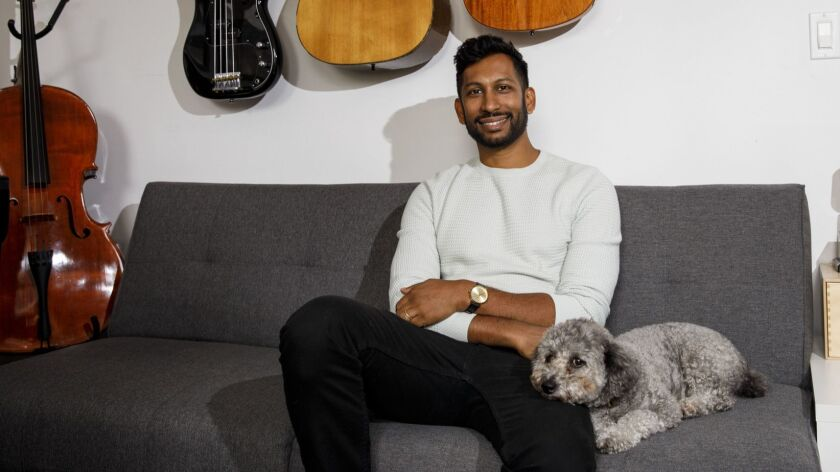 Hrishikesh Hirway, founder of the Song Exploder podcast, sits for a portrait in his home studio on M