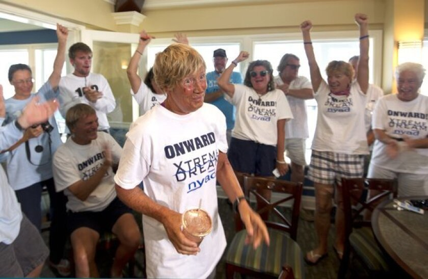Diana Nyad is cheered on by her crew.