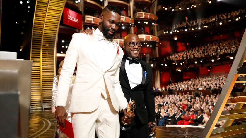 """Writer Tarell Alvin McCraney and director Barry Jenkins win the Oscar for adapted screenplay for """"Moonlight"""" at the 89th Academy Awards at the Dolby Theatre."""