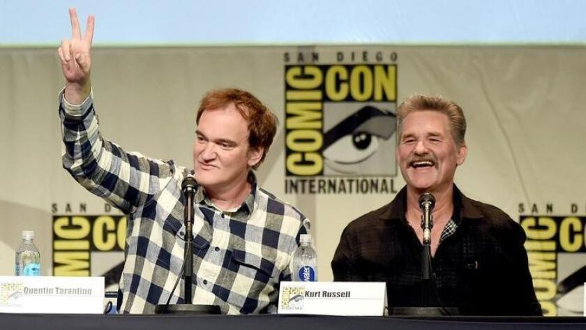 "Writer/director Quentin Tarantino, left, and actor Kurt Russell speak onstage at Quentin Tarantino's ""The Hateful Eight"" panel during Comic-Con International 2015. (Kevin Winter / Getty Images)"