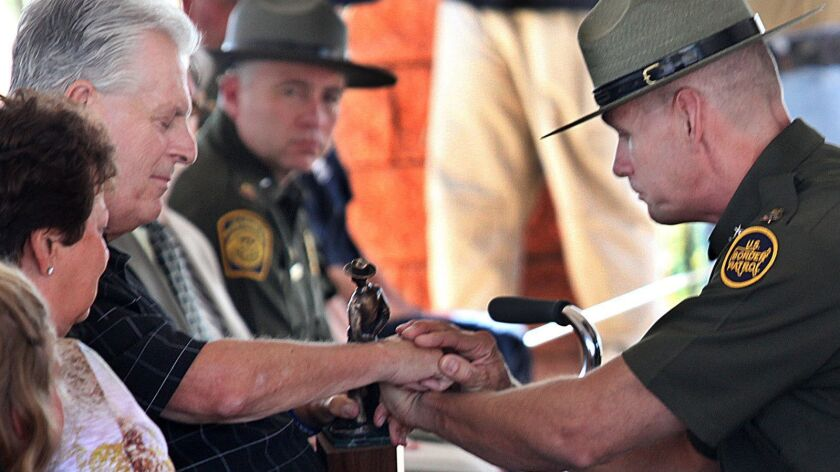 "Kent Terry Sr., father of Border Patrol Agent Brian Terry, and Richard ""Rick"" Barlow, chief patrol a"