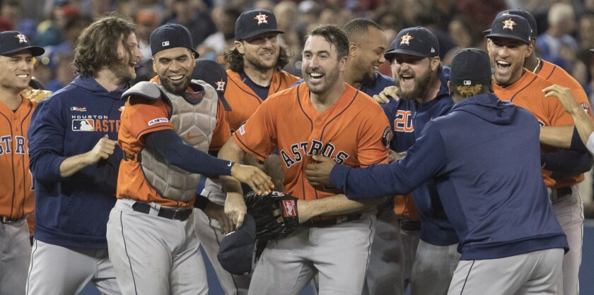 Houston Astros starter Justin Verlander celebrates with his teammates after throwing a no-hitter against the Toronto Blue Jays on Sunday.