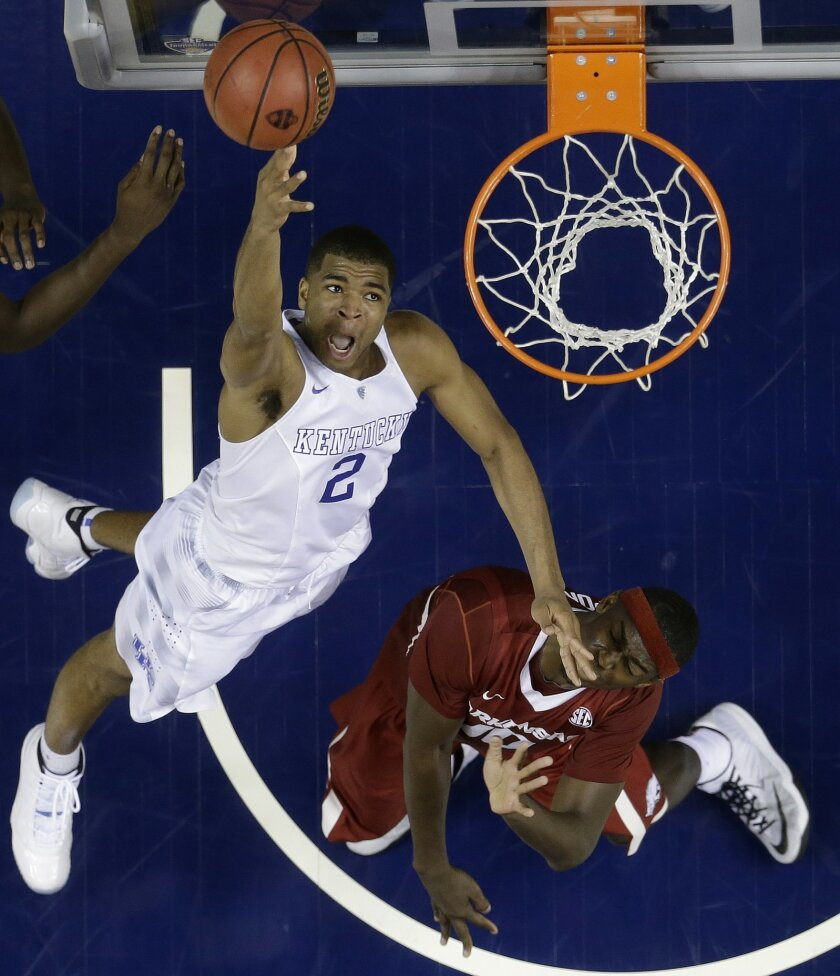 Kentucky guard Aaron Harrison (2) shoots against Arkansas forward Bobby Portis (10) during the second half of the NCAA college basketball Southeastern Conference tournament championship game, Sunday, March 15, 2015, in Nashville, Tenn. Kentucky won 78-63. (AP Photo/Mark Humphrey)