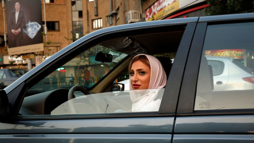 Iran's judiciary has said women must wear the mandatory head covering even in cars. Opponents argue the car is a private space.