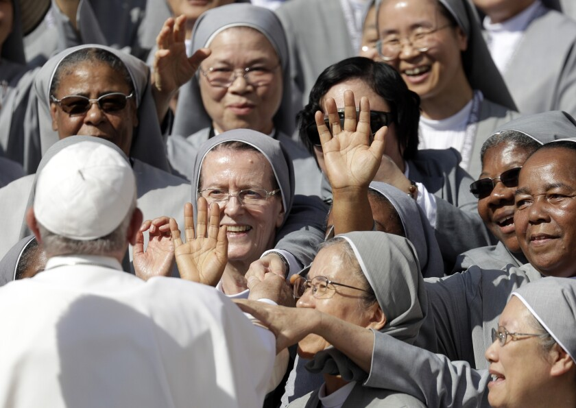 Pope Francis greets nuns during his weekly general audience in St. Peter's Square, at the Vatican, Wednesday, Sept. 25, 2019. (AP Photo/Gregorio Borgia)