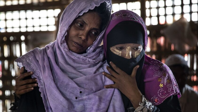 Salema Hatu, left, is held by her daughter Setera at a Doctors Without Borders clinic in Bangladesh on Monday. They are among the thousands of Rohingya who have fled Myanmar.