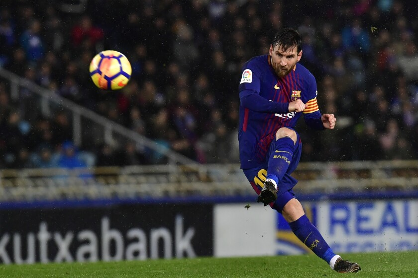 FILE - In this Jan.14, 2018 file photo FC Barcelona's Lionel Messi kicks the ball and scores the fourth goal of his team against Real Sociedad during the Spanish La Liga soccer match between Barcelona and Real Sociedad, at Anoeta stadium, in San Sebastian, northern Spain. Barcelona announced Thursday Aug. 5, 2021 that Lionel Messi will not stay with the club. He is leaving after 17 successful seasons in which he propelled the Catalan club to glory, helping it win numerous domestic and international titles since debuting as a teenager. (AP Photo/Alvaro Barrientos, File)