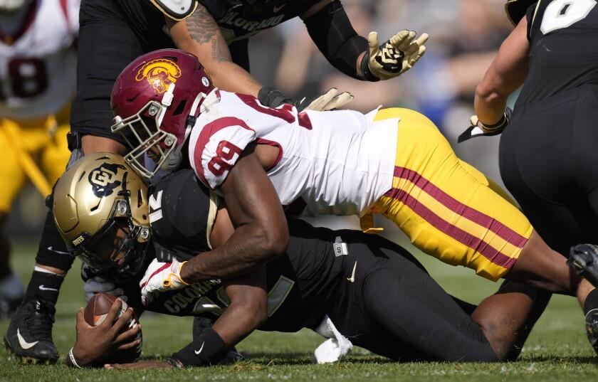 USC's Drake Jackson sacks Colorado's quarterback.