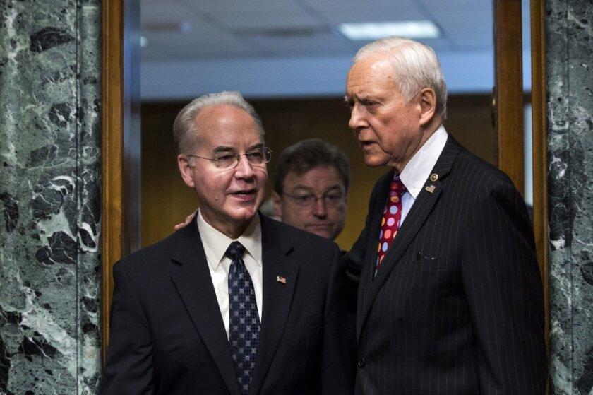 Rep. Tom Price (R-Ga.), left, President Trump's nominee for Health secretary, and Senate Finance Committee Chairman Orrin G. Hatch.