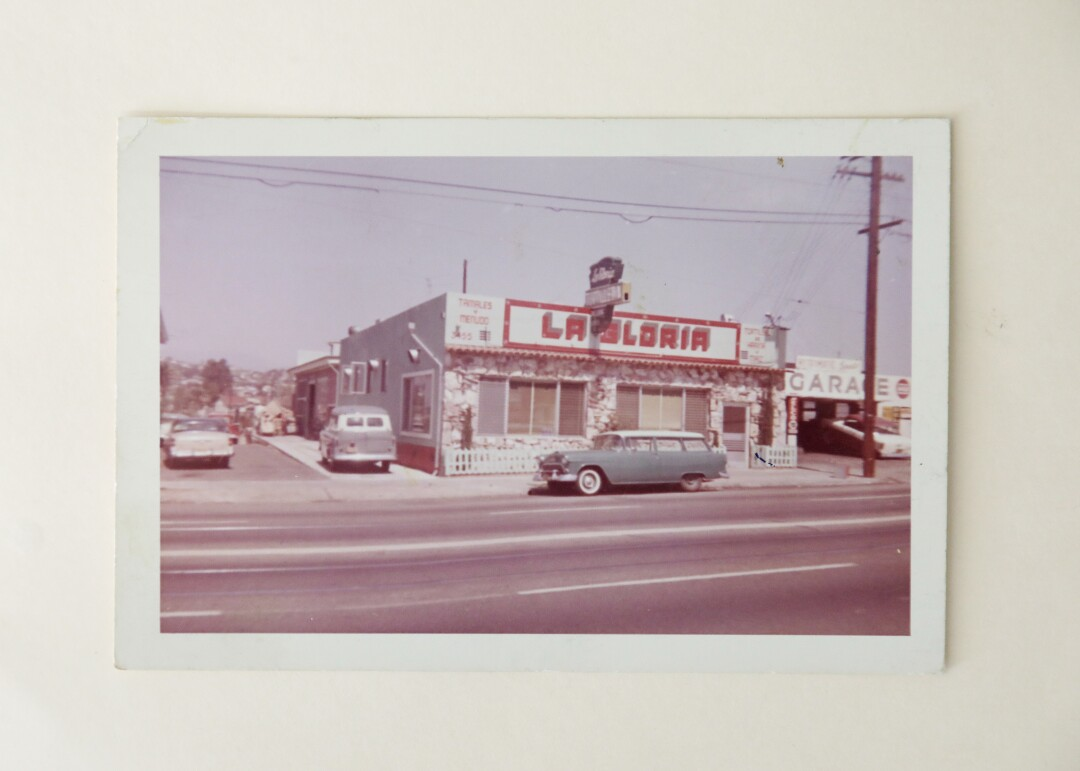 """A 1960s photo shows the exterior of a building with the sign """"La Gloria"""""""