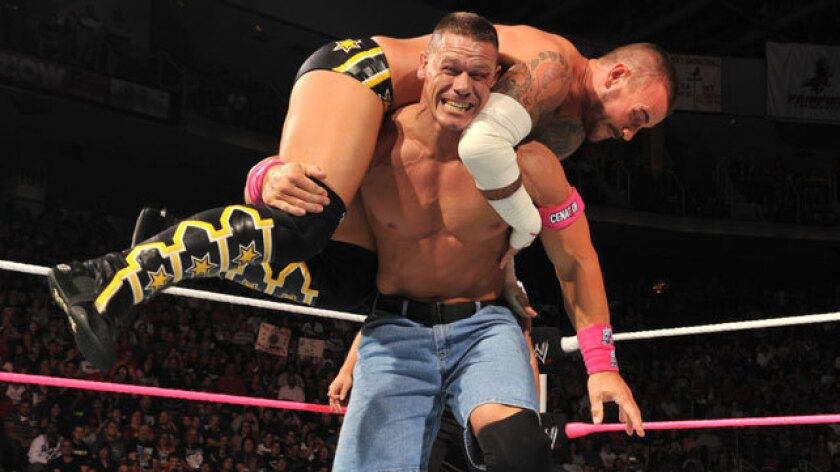 """John Cena hoists CM Punk into the air during """"Night of Champions."""""""