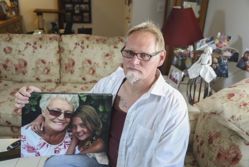 Chuck Beckner with a picture of his mom and niece. Beckner's mom, Billie Sue Matchke, died of COVID-19.