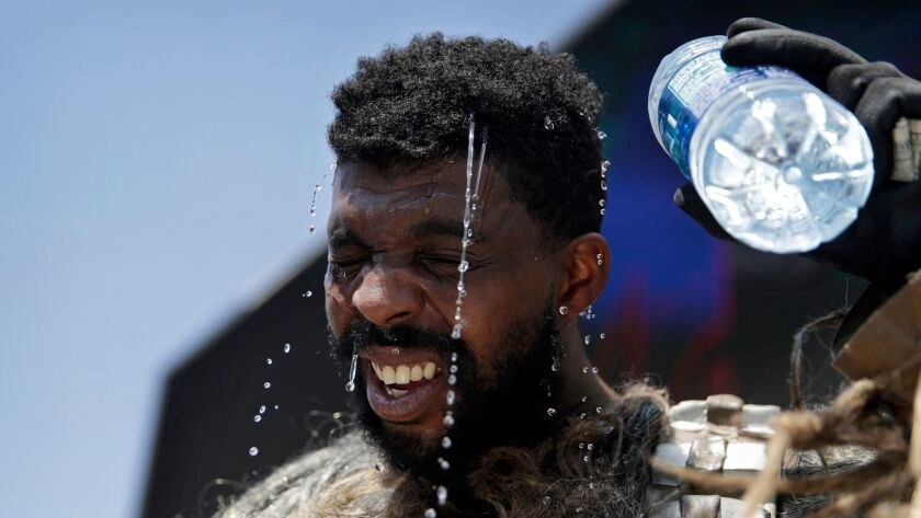 Xaviere Coleman, one of the costumed performers on the Las Vegas Strip, tries to cool off as temperatures skyrocket Tuesday. Coleman, who dresses as a Wookiee, was among a few performers who braved the heat.