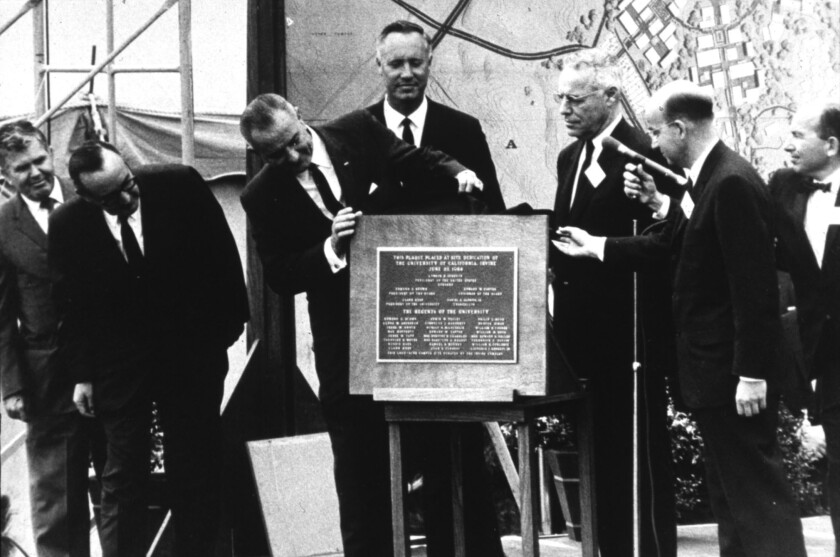 President Johnson, at center unveiling a plaque, at the 1964 dedication of the then-new UC Irvine campus. Now the campus wants President Obama to speak there at its commencement.
