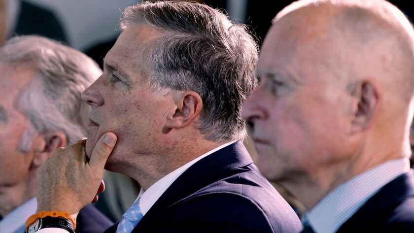 Washington Gov. Jay Inslee and California Gov. Jerry Brown listen to a speaker in San Francisco befo