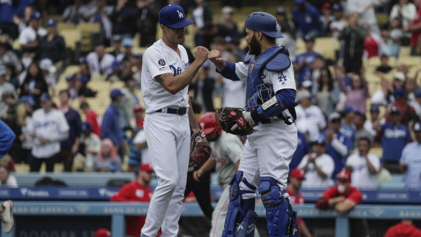 Dodgers catcher Russell Martin congratulates Joe Kelly after a scoreless ninth inning on June 2.