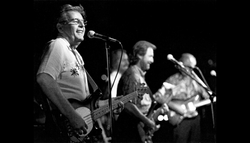 The Chantays perform in Santa Ana in 1994. Brian Carman, left, co-wrote the surf music anthem with fellow Chantay Bob Spickard.