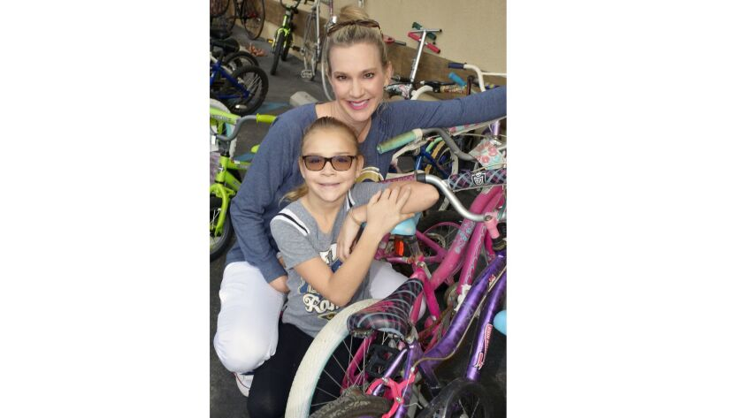 Lisa Matzner Eaton and her daughter Reese, made a donation of two bikes at last week's event