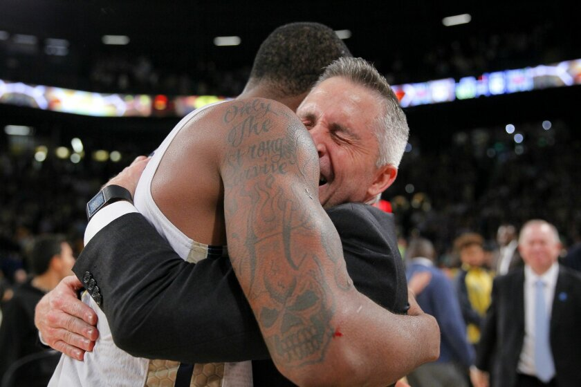 Georgia Tech coach Brian Gregory celebrates with guard Marcus Georges-Hunt at the conclusion of an NCAA college basketball game against Notre Dame in Atlanta, Saturday, Feb. 20, 2016. Georgia Tech won 63-62. (AP Photo/Todd Kirkland)