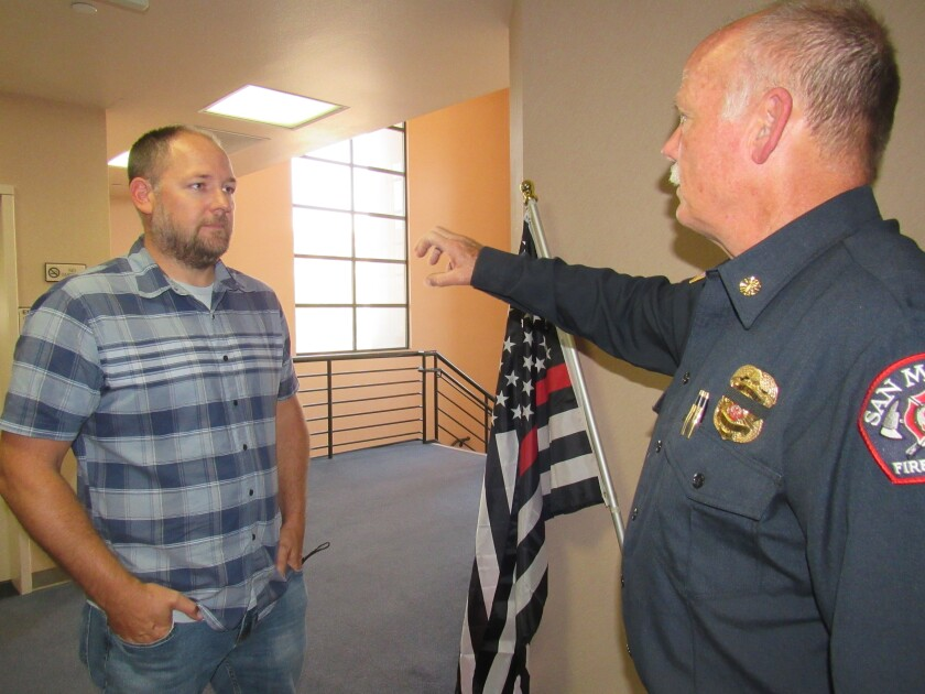 San Miguel Fire Board member Chris Pierce (left) talks with Chief Criss Brainard after Pierce was appointed to the board.
