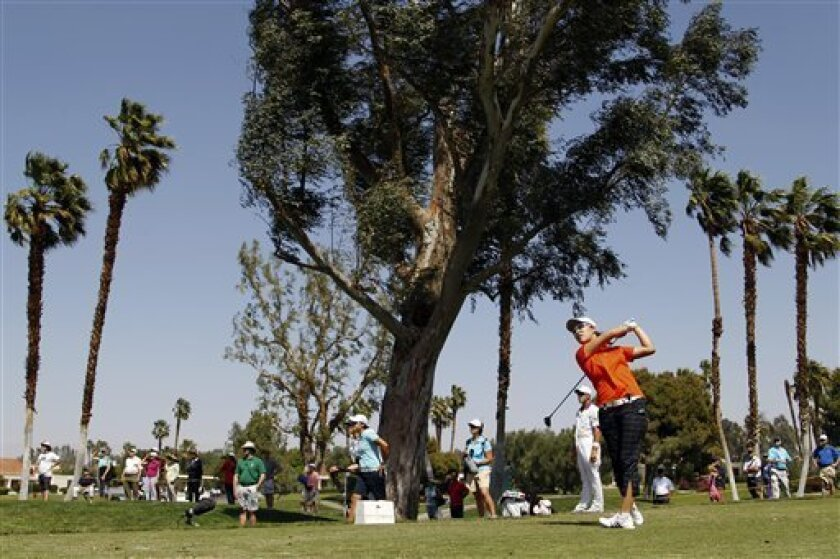 Haeji Kang, of Sourth Korea, watches her shot into the wind on the fifth hole during the third round of the LPGA Kraft Nabisco Championship golf tournament in Rancho Mirage, Calif., Saturday, March 31, 2012. (AP Photo/Chris Carlson)