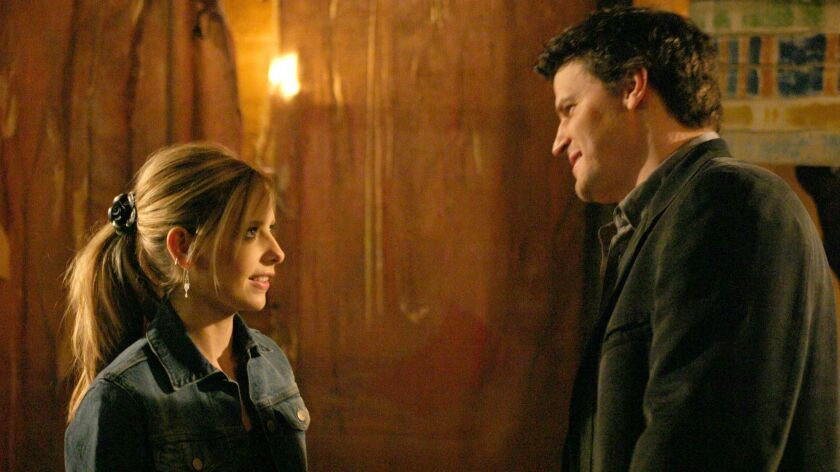 "Buffy (Sarah Michelle Gellar) and Angel (David Boreanaz) in an episode of ""Buffy the Vampire Slayer."""