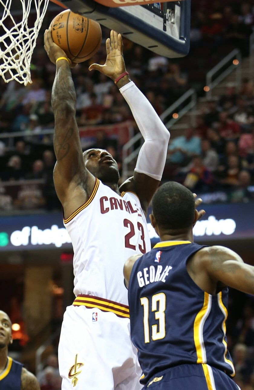 Cleveland Cavaliers forward LeBron James (23) shoots against Indiana Pacers forward Paul George (13) during the first half of an NBA basketball game, Sunday, Nov. 8, 2015, in Cleveland. (AP Photo/Ron Schwane)