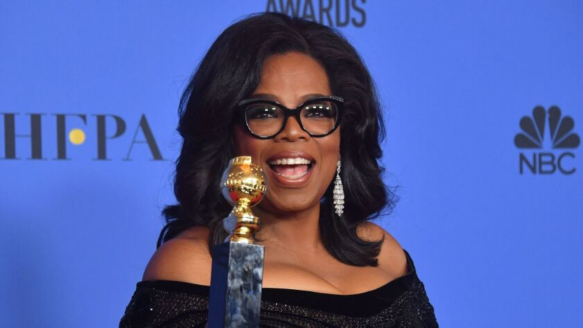 Actress and TV talk show host Oprah Winfrey displays the Cecil B. DeMille Award during the 75th Golden Globe Awards.