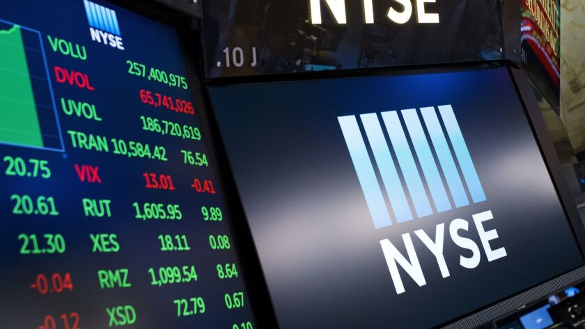 Screens show prices at the New York Stock Exchange.