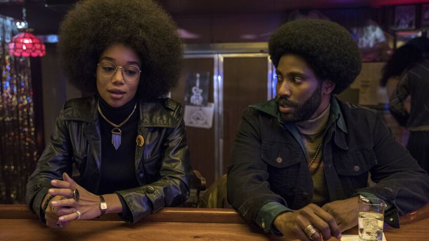 "(L-R) - Laura Harrier stars as Patrice and John David Washington as Ron Stallworth in Spike Lee's ""B"
