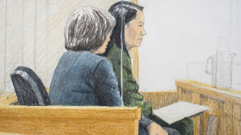 In this courtroom sketch, Meng Wanzhou, right, the chief financial officer of Huawei Technologies, sits beside a translator during a bail hearing in Vancouver, Canada, on Friday.