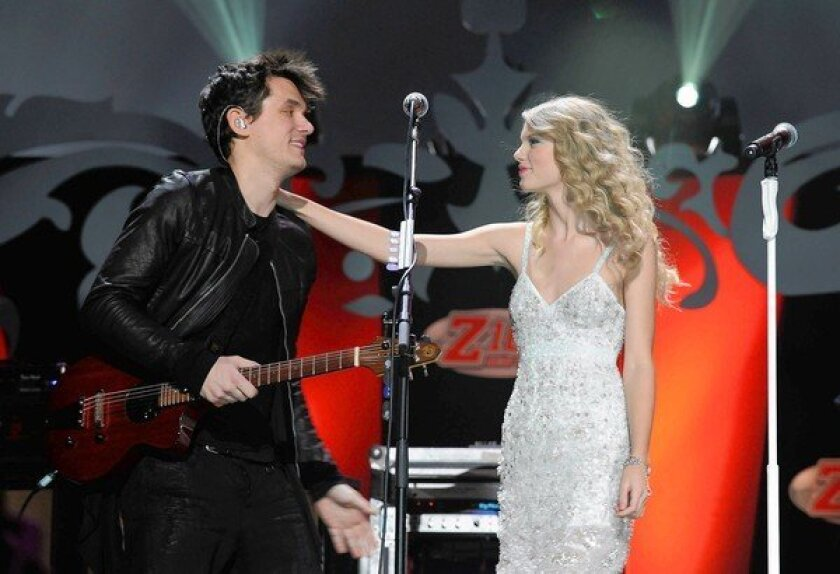 John Mayer and Taylor Swift perform during Z100's Jingle Ball 2009 at Madison Square Garden in New York City.