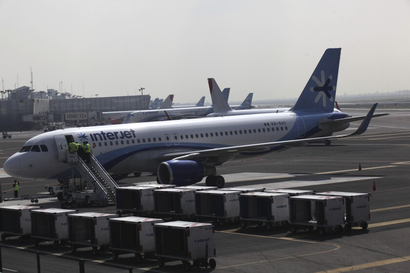 FILE - In this July 8, 2015 file photo, an Interjet plane sits on the tarmac at the Benito Juarez International Airport in Mexico City. The Mexican airline has cancelled its flights for at least two days, Nov. 1 and 2, citing cash-flow problems and fleet maintenance. (AP Photo/Marco Ugarte, File)
