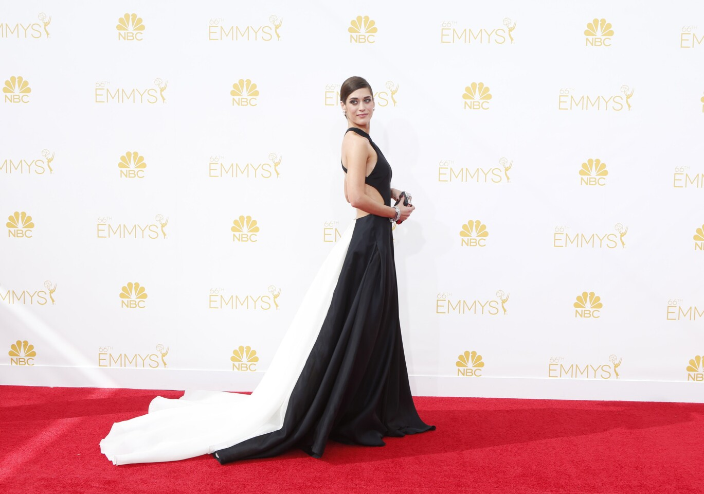 Lizzy Caplan arriving at the 2014 Emmy Awards at L.A. Live.