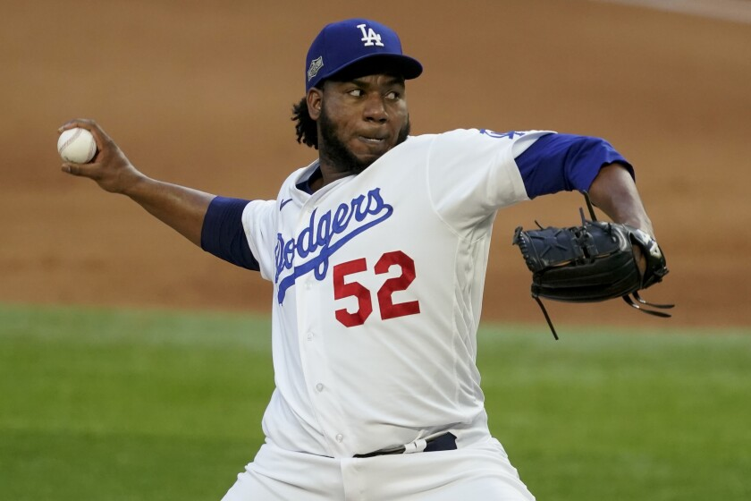 Dodgers relief pitcher Pedro Baez throws against the Atlanta Braves.