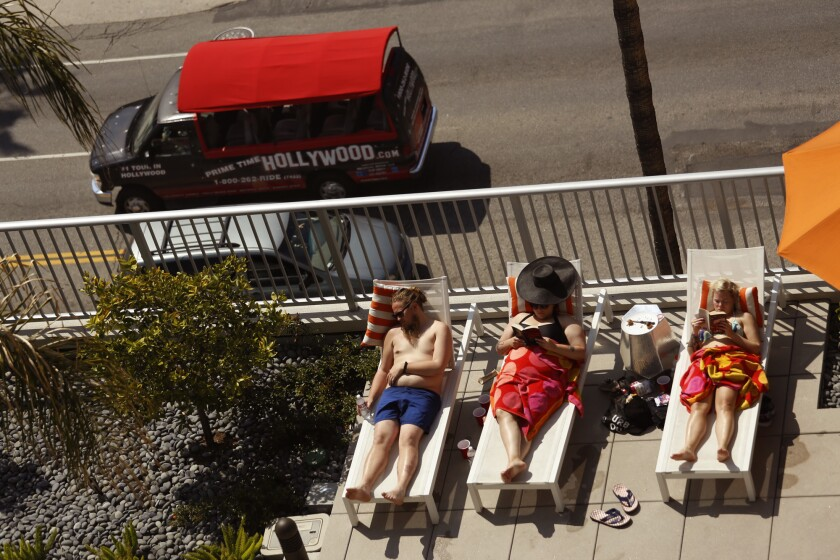Visitors sun themselves poolside at the Sunset and Gordon building in Hollywood on April 11, 2015.
