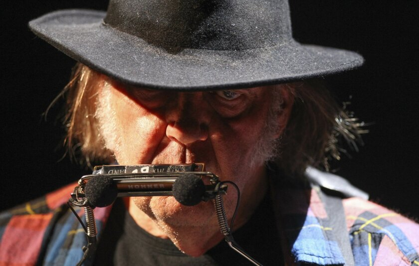 Neil Young performs at the RIMAC Arena.