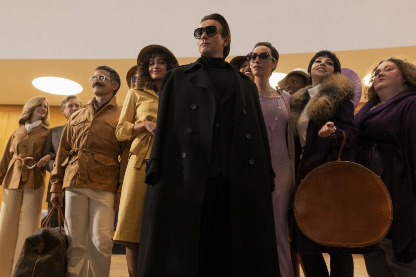 """A scene from """"Halston"""" showing Ewan McGregor as the famed fashion designer surrounded by his entourage."""