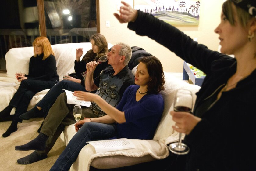 Artist, from left, Marilyn Fraser, Elena Karavodin, Darrel McPherson, Cedar Lee, and Jennifer Anichowski discuss a painting as they participate in an artists critique group at Lee's home in Escondido on Wednesday.
