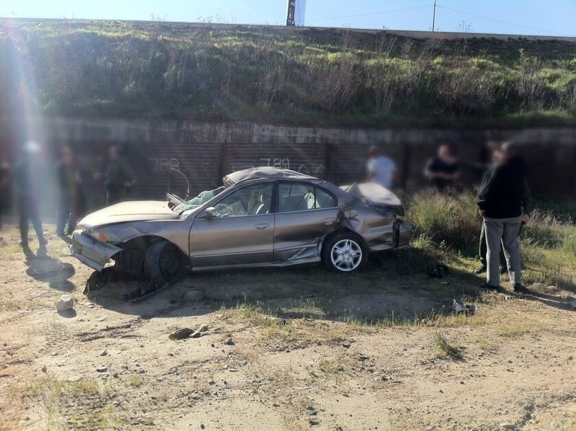 Two were injured in a crash Tuesday over the international border fence. The image was blurred by the Border Patrol to conceal the identities of plain-clothes officers.