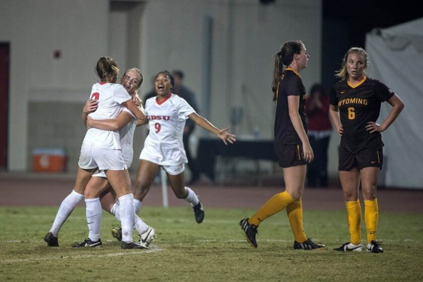 SDSU senior Katie Perry celebrates her overtime goal in Saturday's Mountain West final at the Sports Deck that put the Aztecs into the NCAA Tournament. Photo courtesy of Mountain West.