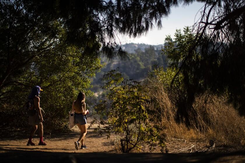 Hikers leave Peanut Lake.