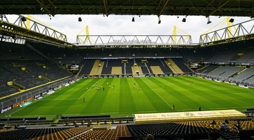 Empty seats are seen in the Signal Iduna Park without spectators  during the German Bundesliga soccer match between Borussia Dortmund and Schalke 04 in Dortmund, Germany on Sautrday.