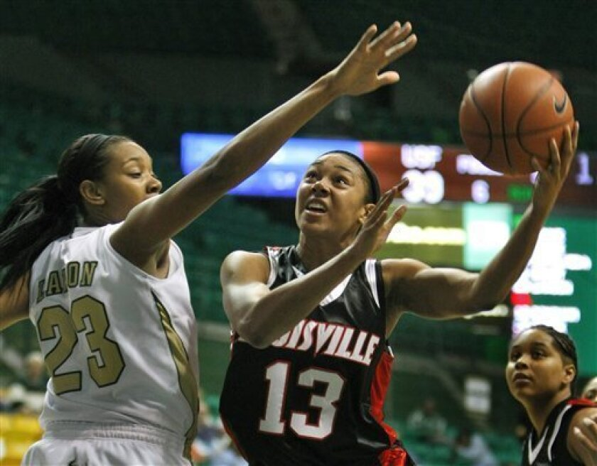 Louisville forward Candyce Bingham (13) puts up a second-half shot over South Florida's Jessica Lawson (23) during an NCAA women's college basketball game Wednesday, Jan. 14, 2009 in Tampa, Fla. Louisville won the game 76-60. (AP Photo/Chris O'Meara)