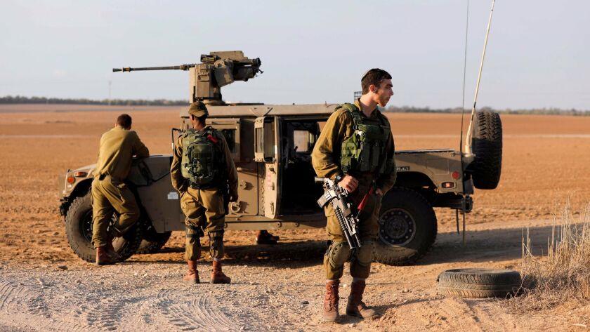Israeli soldiers patrol near the Israeli border with the Gaza Strip on Oct. 30, 2017, near Kibbutz Kissufim in southern Israel.